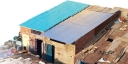 Roofing material made from recycled cardboard on a home in Ahmedabad, India