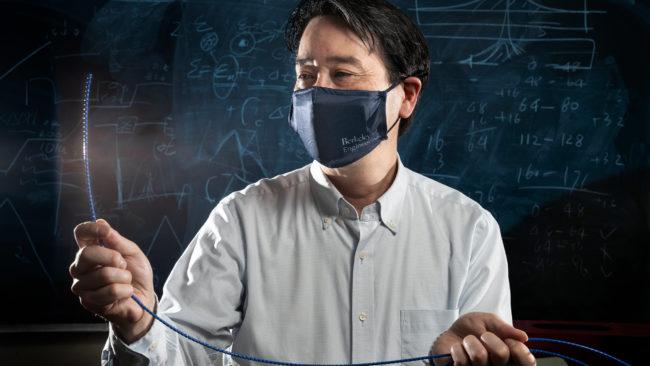 Kenichi Soga holding fiber optic cable