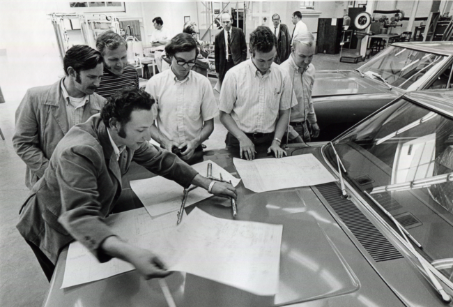 Peter Venturini shares mechanical drawings with his team.