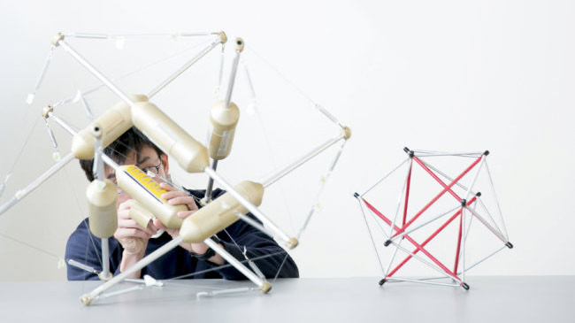 Student with tensegrity robot