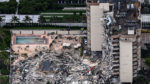 Search and rescue personnel work on the debris pile at the Champlain Towers South collapse site.