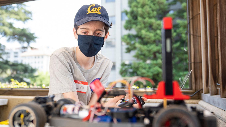 ROAR Academy student with race car