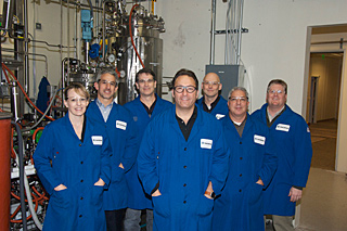 INVENTIVE: David Walther (B.S.'92 ME/MSE, M.S.'97 ME, Ph.D.'98 ME), far right, with fellow executives at the Cobalt Biofuels pilot plant. The Mountain View startup is working on next-generation biofuels. PHOTO COURTESY DAVID WALTHER