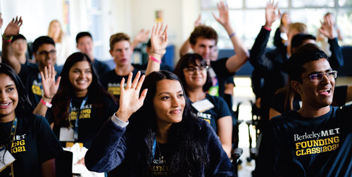 MET program students raising hands in classroom