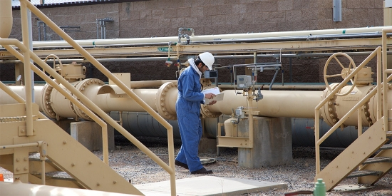 Inspector checking natural gas pipeline