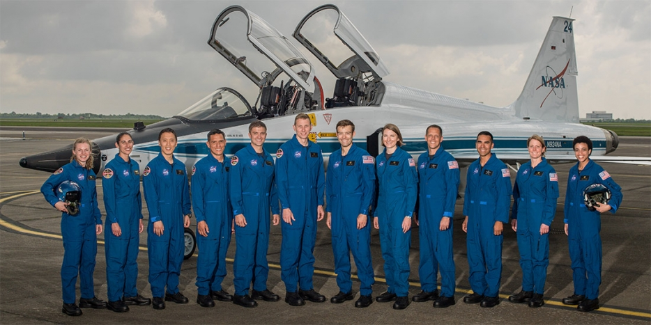 NASA's 12 new astronaut candidates in front of a NASA jet
